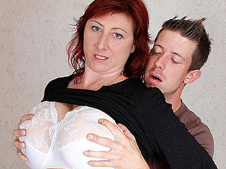 Fascinating red haired slut is showing off her huge biggest boobs