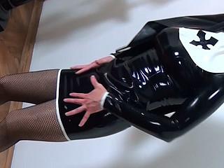 Kinky hottie in latex nun suit posing seductively