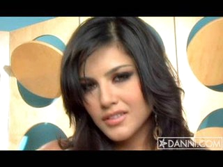 Sunny Leone exhibiting her lovely and meaty jugs are on the ottoman