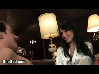 Glamour brunette tranny sucked by a guy
