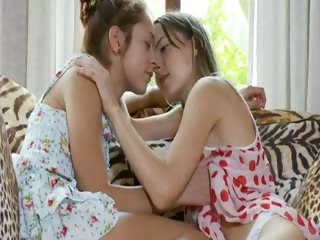 Two horny lesbian teens pleasuring love tunnel by fingering