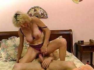 Busty mature blonde eats younger man's pecker and gets drilled in the gazoo